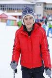 Muchacho feliz que goza en nieve Imágenes de archivo libres de regalías