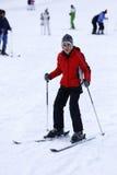 Muchacho feliz que goza en nieve Imagen de archivo libre de regalías