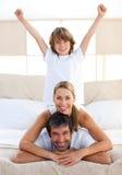 Muchacho feliz que juega con sus padres Imagen de archivo libre de regalías