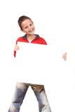 Muchacho feliz que lleva a cabo una tarjeta de la muestra Imagen de archivo libre de regalías