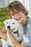 Muchacho feliz y su perro Imágenes de archivo libres de regalías