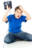 Muchacho frustrado con una palanca de mando Imagen de archivo libre de regalías