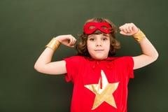 Muchacho fuerte en traje del super héroe Imagen de archivo libre de regalías