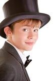 Muchacho hermoso en traje y sombrero de copa formales Imagen de archivo libre de regalías