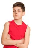 Muchacho hermoso pensativo en rojo Foto de archivo libre de regalías