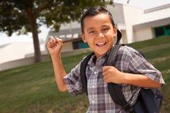 Muchacho hispánico joven feliz listo para la escuela Imágenes de archivo libres de regalías