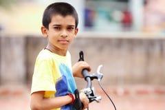 Muchacho indio con la bicicleta Imagen de archivo