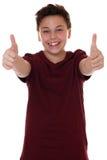 Muchacho joven acertado del adolescente que muestra los pulgares para arriba Fotografía de archivo