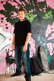 Muchacho joven con el bolso de hombro Fotos de archivo libres de regalías