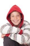 Muchacho joven con el capo motor rojo Imagen de archivo