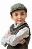 Muchacho joven con el chaleco y el casquillo plano fotografía de archivo