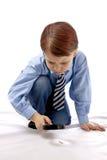 Muchacho joven con el magnifer Fotografía de archivo libre de regalías