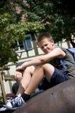 Muchacho joven con el morral Imagenes de archivo