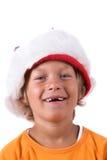Muchacho joven con el sombrero de la Navidad Imágenes de archivo libres de regalías