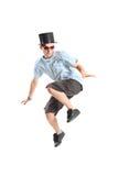 Muchacho joven con el sombrero mágico en salto Imagen de archivo libre de regalías