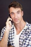 Muchacho joven con el teléfono elegante Imagen de archivo libre de regalías