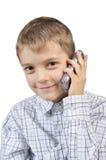 Muchacho joven con el teléfono móvil Imagen de archivo