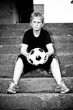 Muchacho joven con la bola Fotos de archivo libres de regalías