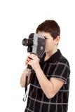 Muchacho joven con la cámara vieja del análogo 8m m del vintage Foto de archivo libre de regalías