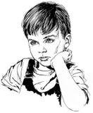 Muchacho joven con la mano en Chin Fotos de archivo libres de regalías