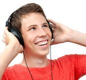 Muchacho joven con los auriculares Imagenes de archivo