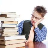 Muchacho joven con los libros Imagen de archivo