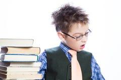 Muchacho joven con los libros Foto de archivo libre de regalías