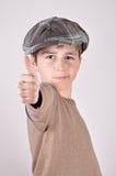 Muchacho joven con un pulgar para arriba Imagen de archivo