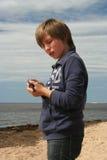 Muchacho joven con una pistola del juguete Foto de archivo libre de regalías