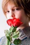Muchacho joven con una rosa Fotografía de archivo