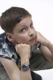 Muchacho joven de pensamiento fotografía de archivo libre de regalías