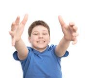 Muchacho joven de risa feliz aislado Imágenes de archivo libres de regalías