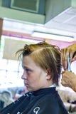 Muchacho joven en el peluquero Imagen de archivo