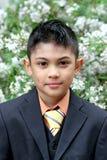 Muchacho joven en la chaqueta Fotos de archivo