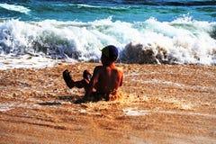 Muchacho joven en la playa Fotografía de archivo libre de regalías