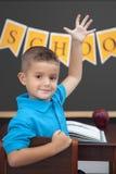 Muchacho joven en la sala de clase Fotografía de archivo
