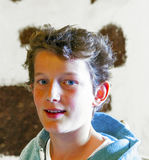 Muchacho joven en un restaurante Fotos de archivo libres de regalías