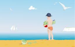 Muchacho joven en una playa Imágenes de archivo libres de regalías