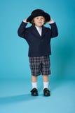 Muchacho joven en uniforme escolar Foto de archivo libre de regalías