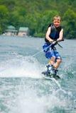 Muchacho joven en Wakeboard foto de archivo libre de regalías