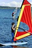 Muchacho joven en windsurfing Imágenes de archivo libres de regalías