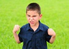 Muchacho joven enojado imagenes de archivo
