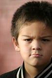 Muchacho joven enojado Foto de archivo libre de regalías