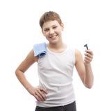 Muchacho joven feliz en una camisa sin mangas Fotografía de archivo