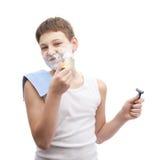 Muchacho joven feliz en una camisa sin mangas Imagen de archivo libre de regalías