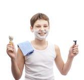 Muchacho joven feliz en una camisa sin mangas Foto de archivo