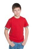 Muchacho joven hermoso en camisa roja Imágenes de archivo libres de regalías