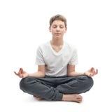 Muchacho joven meditating Imagen de archivo libre de regalías