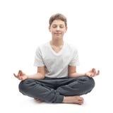 Muchacho joven meditating Foto de archivo libre de regalías