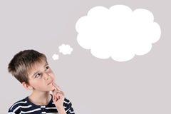 Muchacho joven pensativo Imagen de archivo libre de regalías